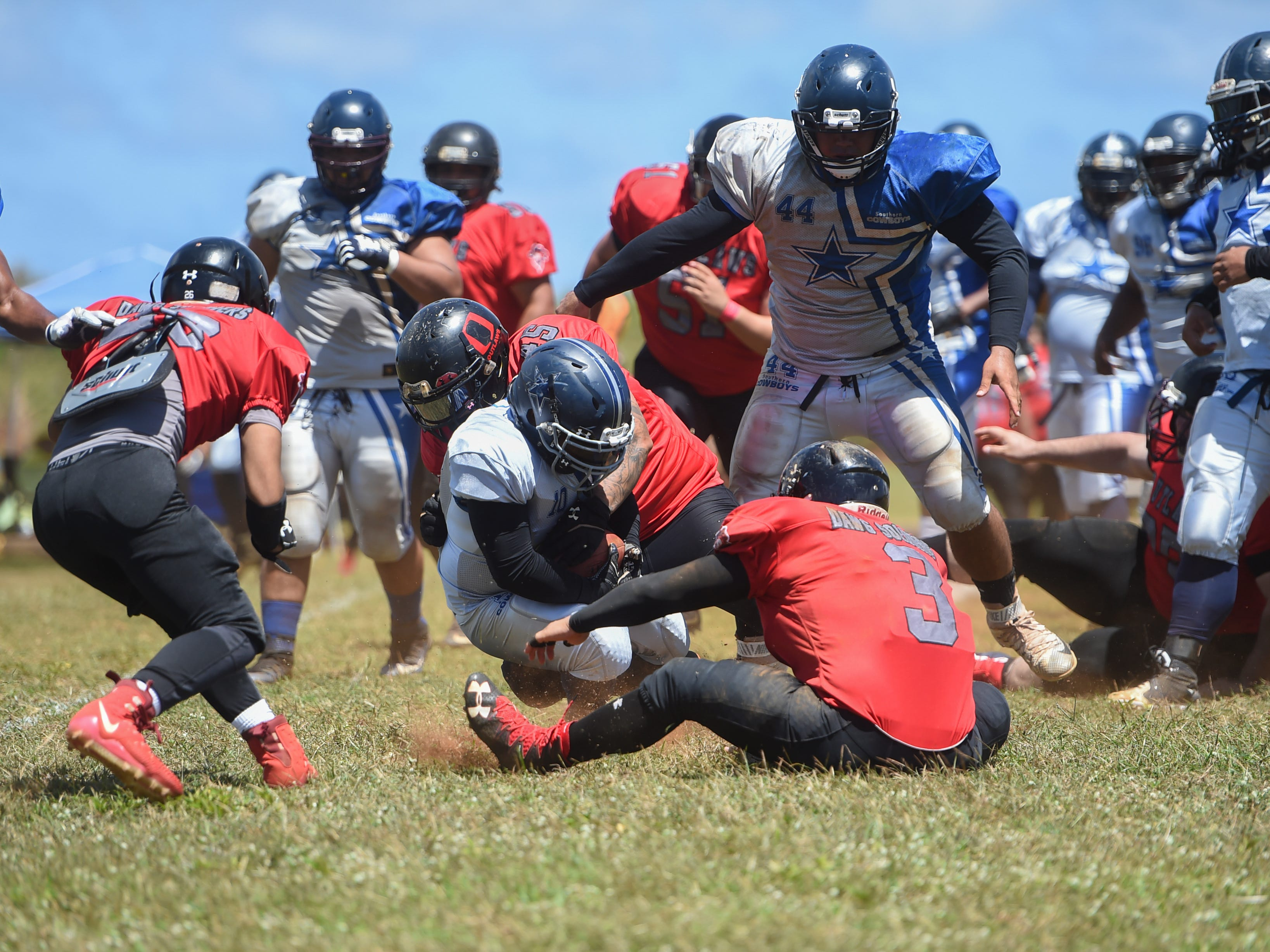 The Southern Cowboys' Robert Tedtaotao (10) is taken down by the Outlaws' defense during a Budweiser Guahan Varsity Football League game at Eagles Field in Mangilao, March 9, 2019.