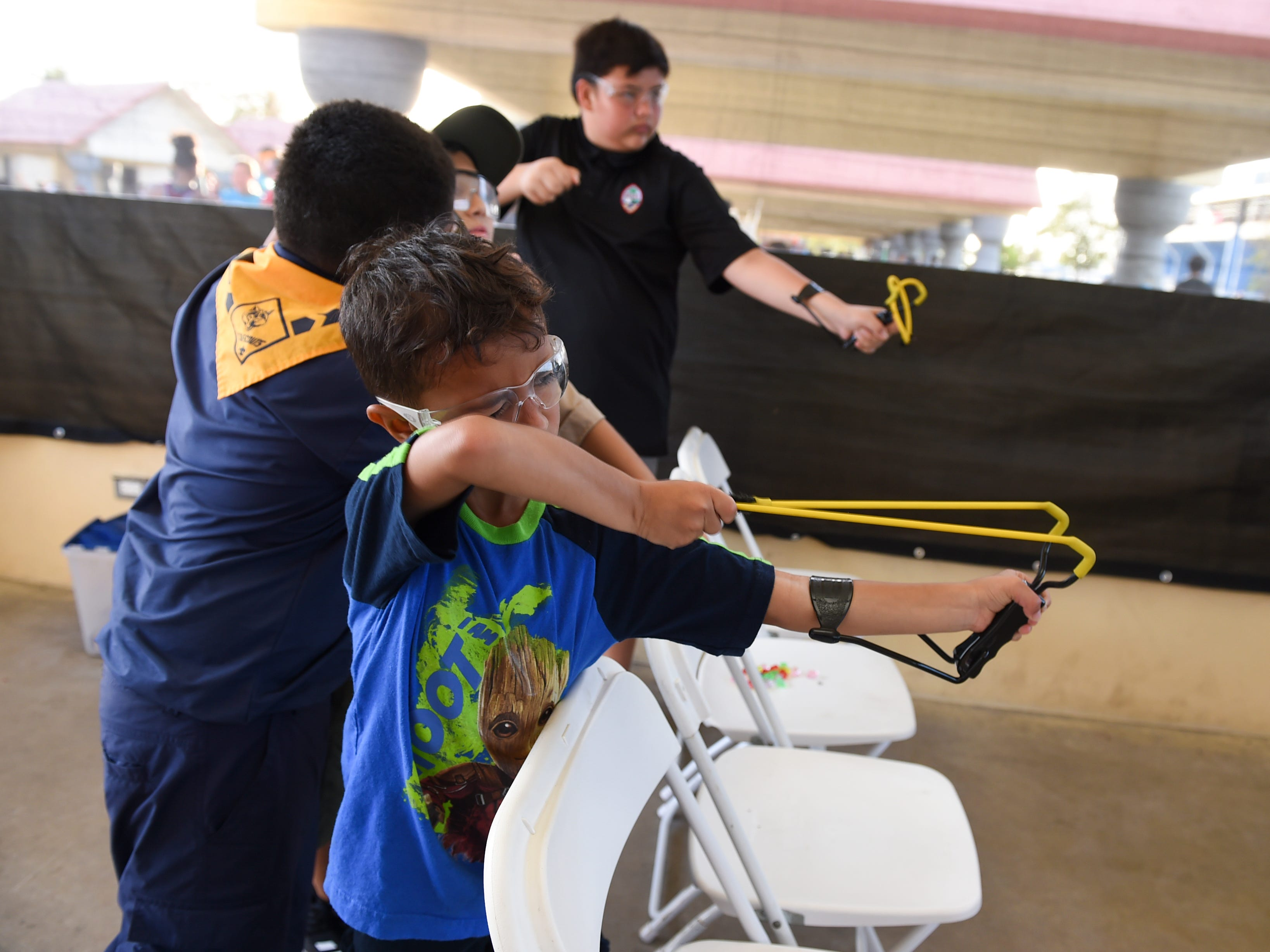 Damian Pomare, 6, aims with a slingshot in the Boy Scouts of America Kid Zone booth during the Bank of Guam Ifit Run and Block Party at Chamorro Village in Hagåtña, March 9, 2019.