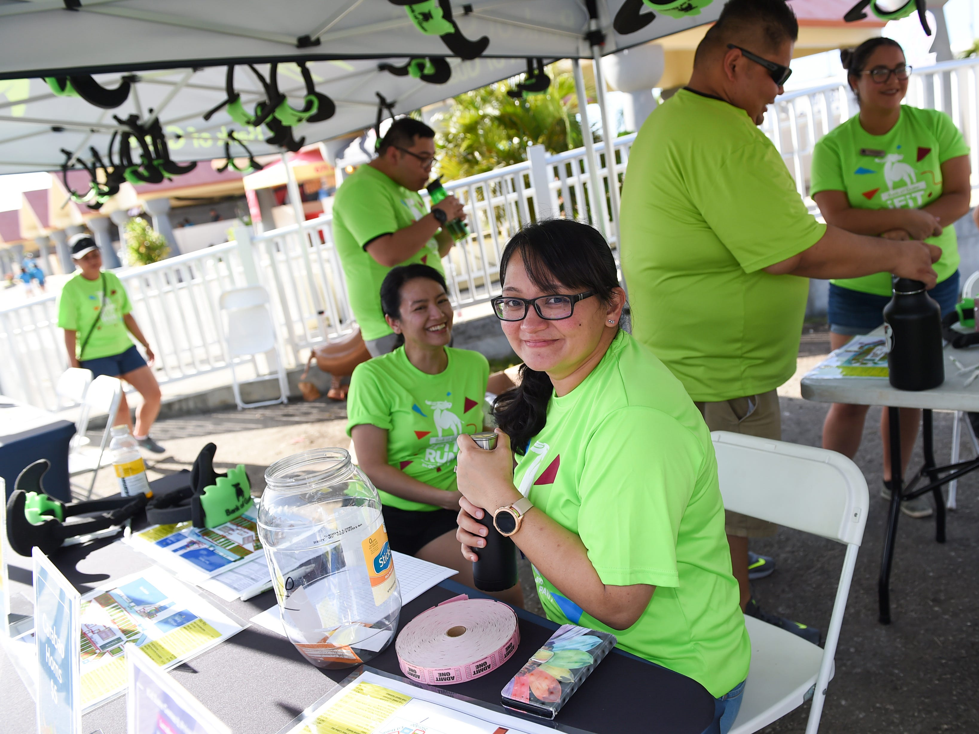Bank of Guam employees at their ticket booth during the Bank of Guam Ifit Run and Block Party at Chamorro Village in Hagåtña, March 9, 2019.