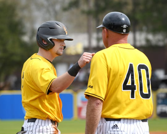In this file photo, Southern Miss infielder Matthew Guidry talks with head coach Scott Berry at third base in a game against Holy Cross at Pete Taylor Park.