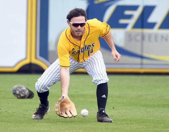 Southern Miss outfielder Gabe Montenegro scoops up the ball in a game against Holy Cross at Pete Taylor Park on Saturday, March 9, 2019.