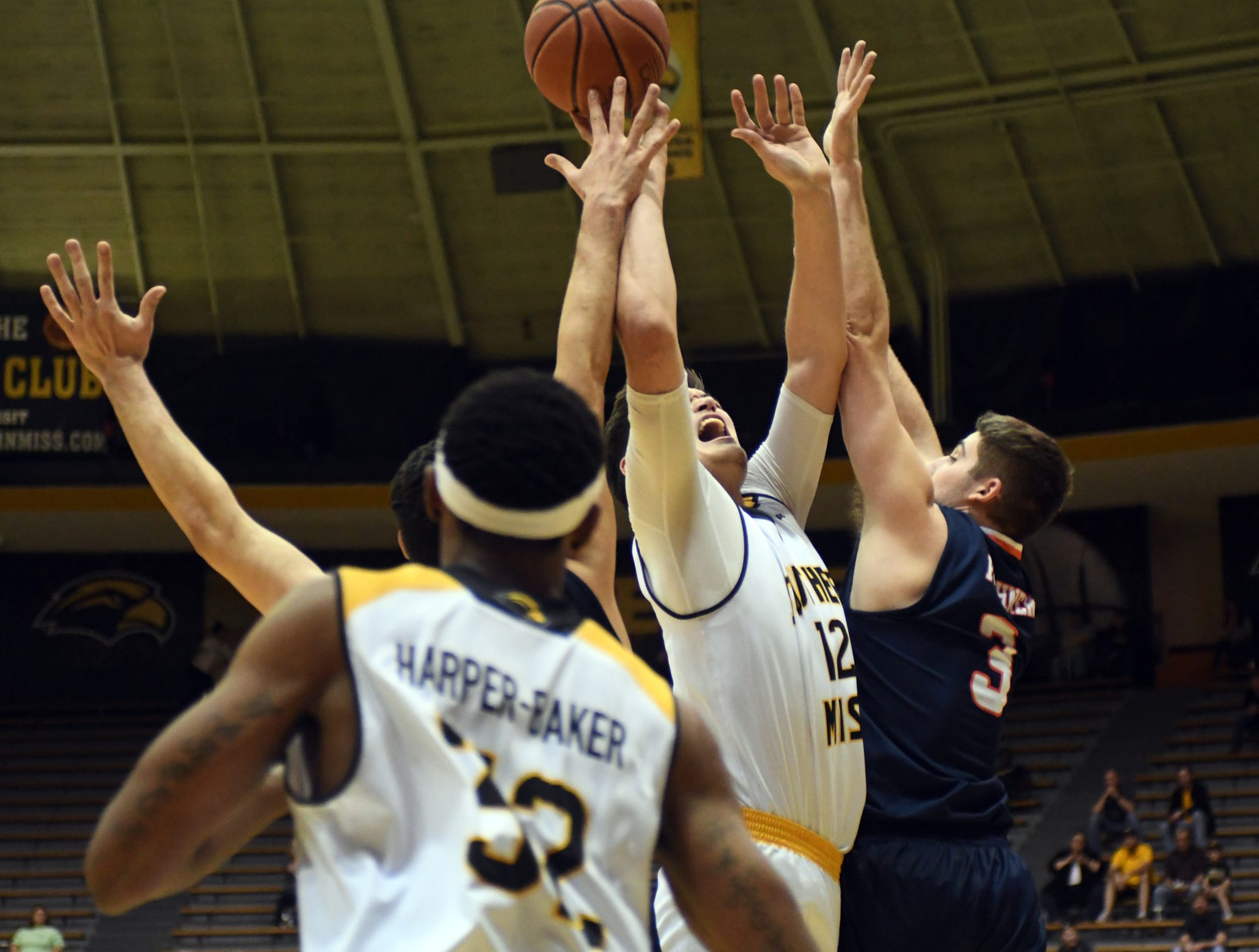 Southern Miss forward Tim Rowe reaches for a loose ball in a game against UTSA in Reed Green Coliseum on Saturday, March 9, 2019.