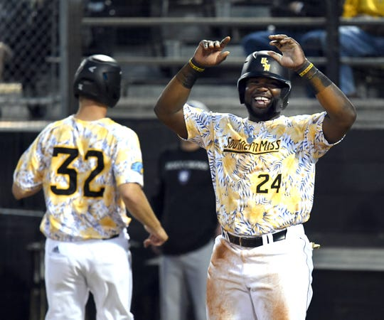 Southern Miss' Erick Hoard celebrates after making it to home base in a game against Holy Cross at Pete Taylor Park on Friday, March 8, 2019.