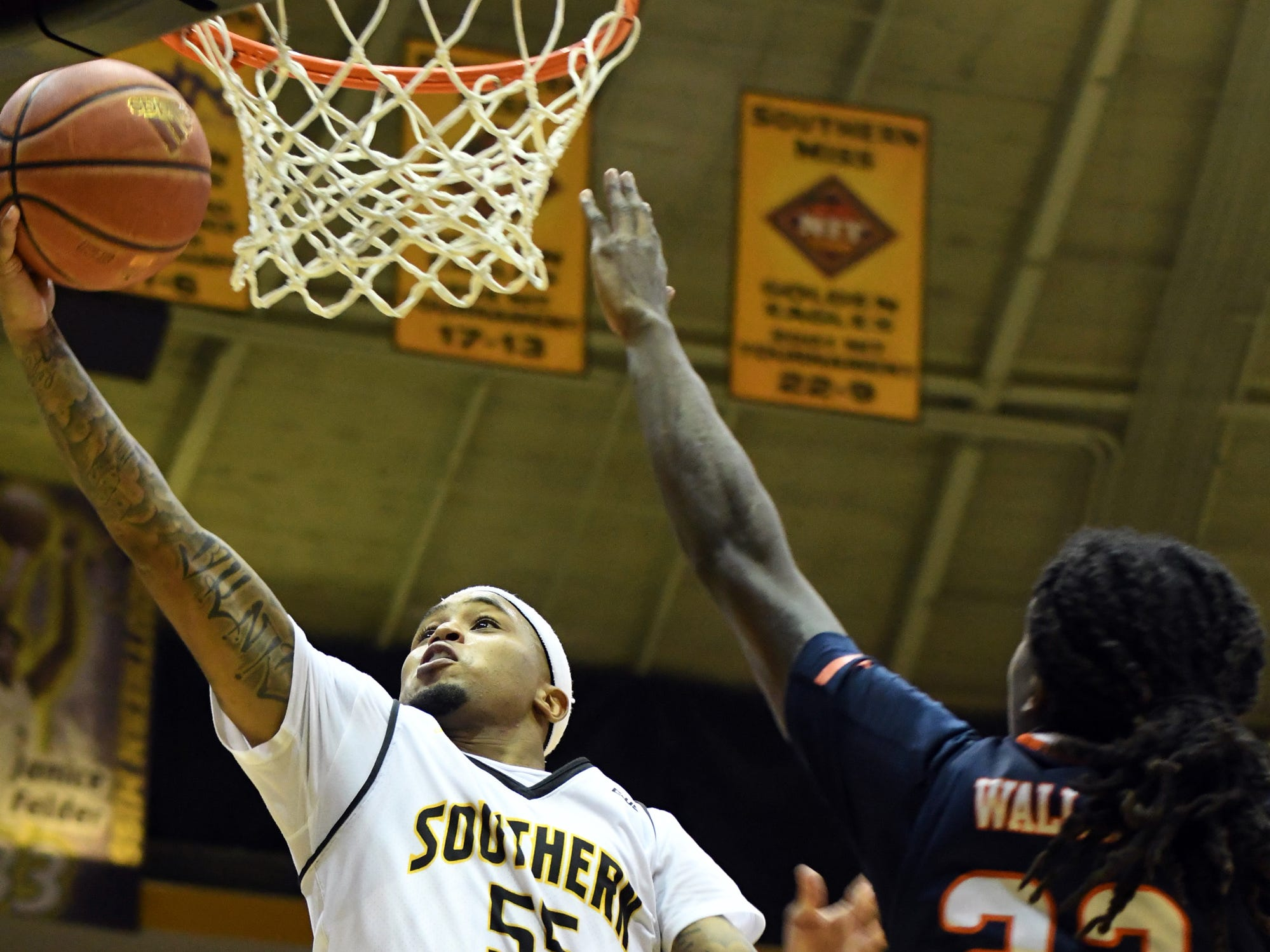 Southern Miss guard Tyree Griffin reaches for the basket  in a game against UTSA in Reed Green Coliseum on Saturday, March 9, 2019.