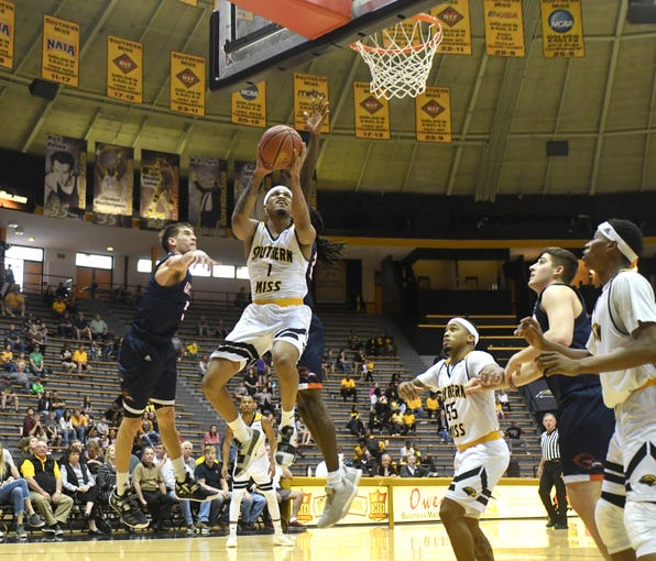 Southern Miss guard Cortez Edwards reaches for the basket in a game against UTSA in Reed Green Coliseum on Saturday, March 9, 2019.