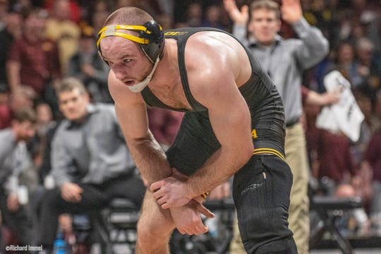 Iowa's Alex Marinelli maintains his stance against Ohio State's Te'Shan Campbell during the 2019 Big Ten Championships at Williams Arena in Minneapolis, Minnesota. Marinelli beat Campbell, 6-3, to advance at 165 pounds.