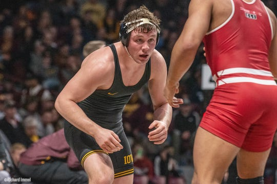 Iowa's Jacob Warner wrestles Wisconsin's Beau Breske at the 2019 Big Ten Championships at Williams Arena in Minneapolis, Minnesota. Warner beat Breske, 10-4, to advance at 197 pounds.