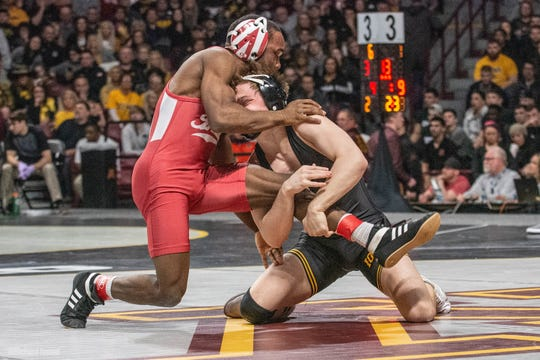 Iowa's Spencer Lee works for a takedown against Indiana's Elijah Oliver at the 2019 Big Ten Championships at Williams Arena in Minneapolis, Minnesota. Lee pinned Oliver in the first period to advance at 125 pounds.
