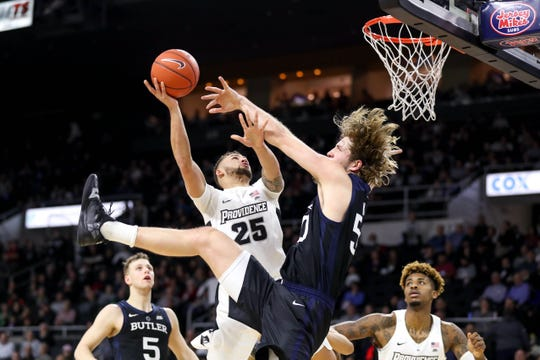 Providence College Friars guard Drew Edwards (25) shoots defended by Butler Bulldogs center Joey Brunk (50) during the second half at Dunkin Donuts Center.