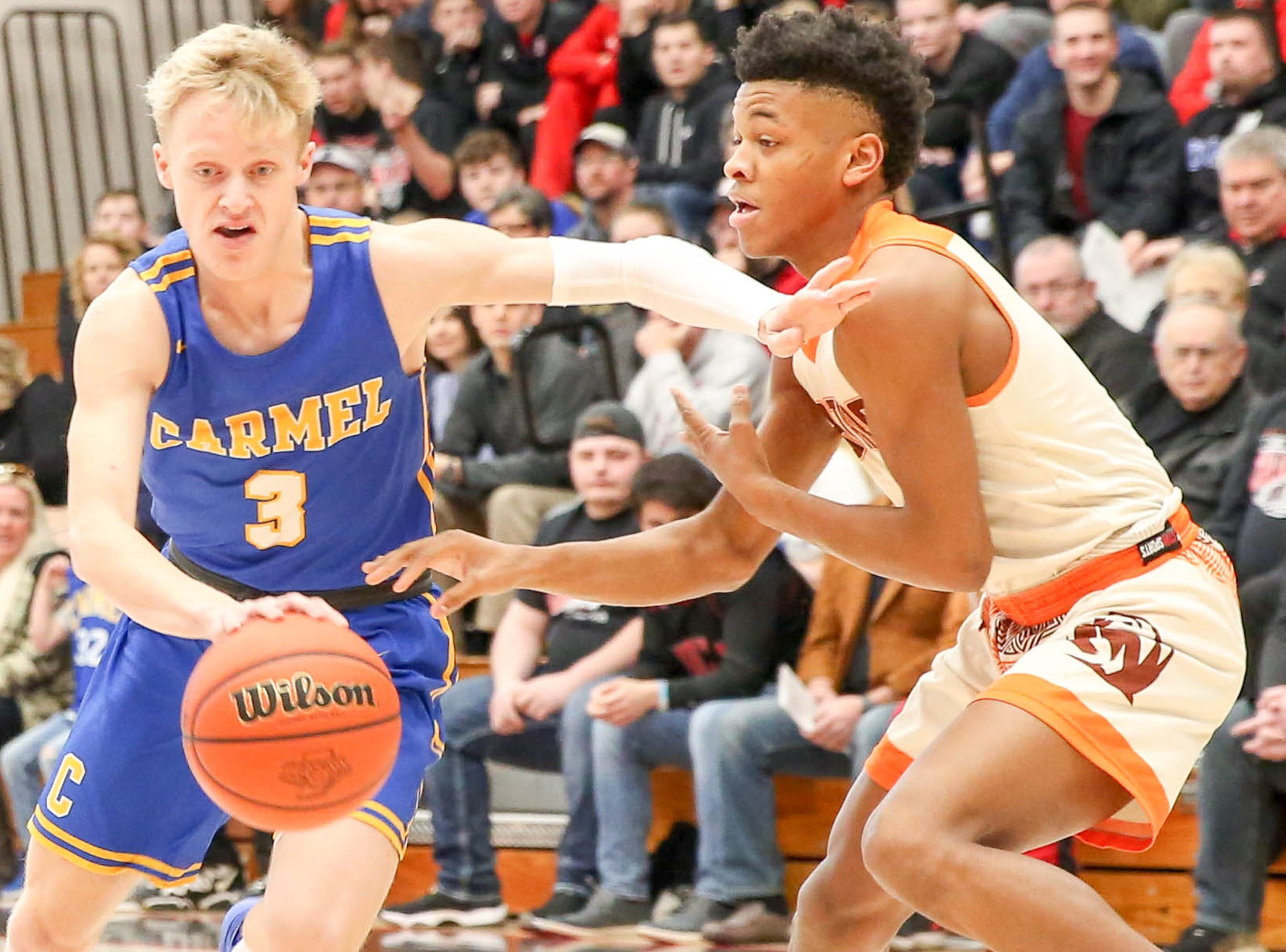 Carmel's Karsten Windlan (3) drives to the basket during Saturday's regional semifinal against FW Northrop. The Greyhounds beat Zionsville in the nightcap.