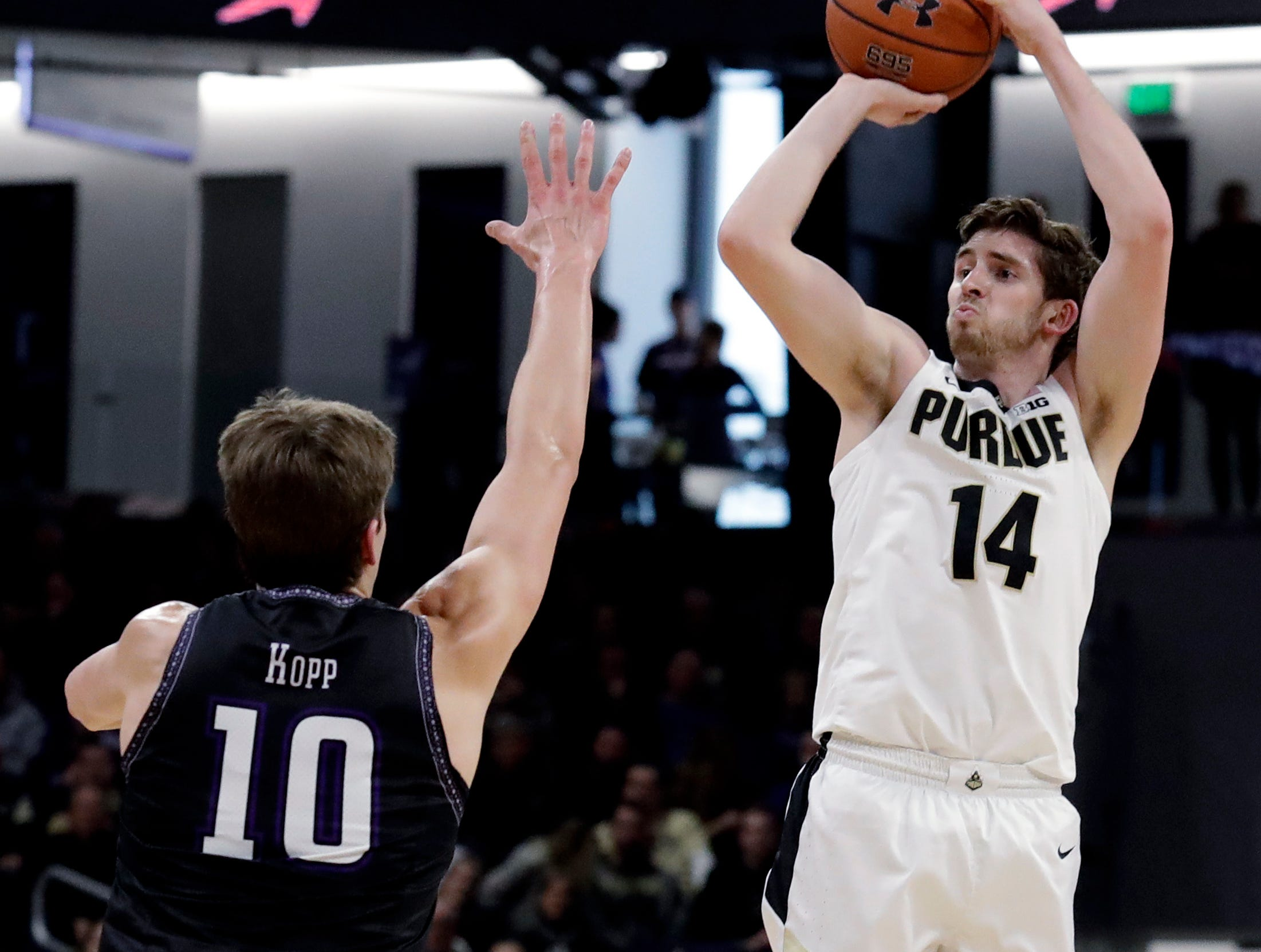 Purdue guard Ryan Cline, right, shoots against Northwestern forward Miller Kopp during the first half of an NCAA college basketball game Saturday, March 9, 2019, in Evanston, Ill. (AP Photo/Nam Y. Huh)