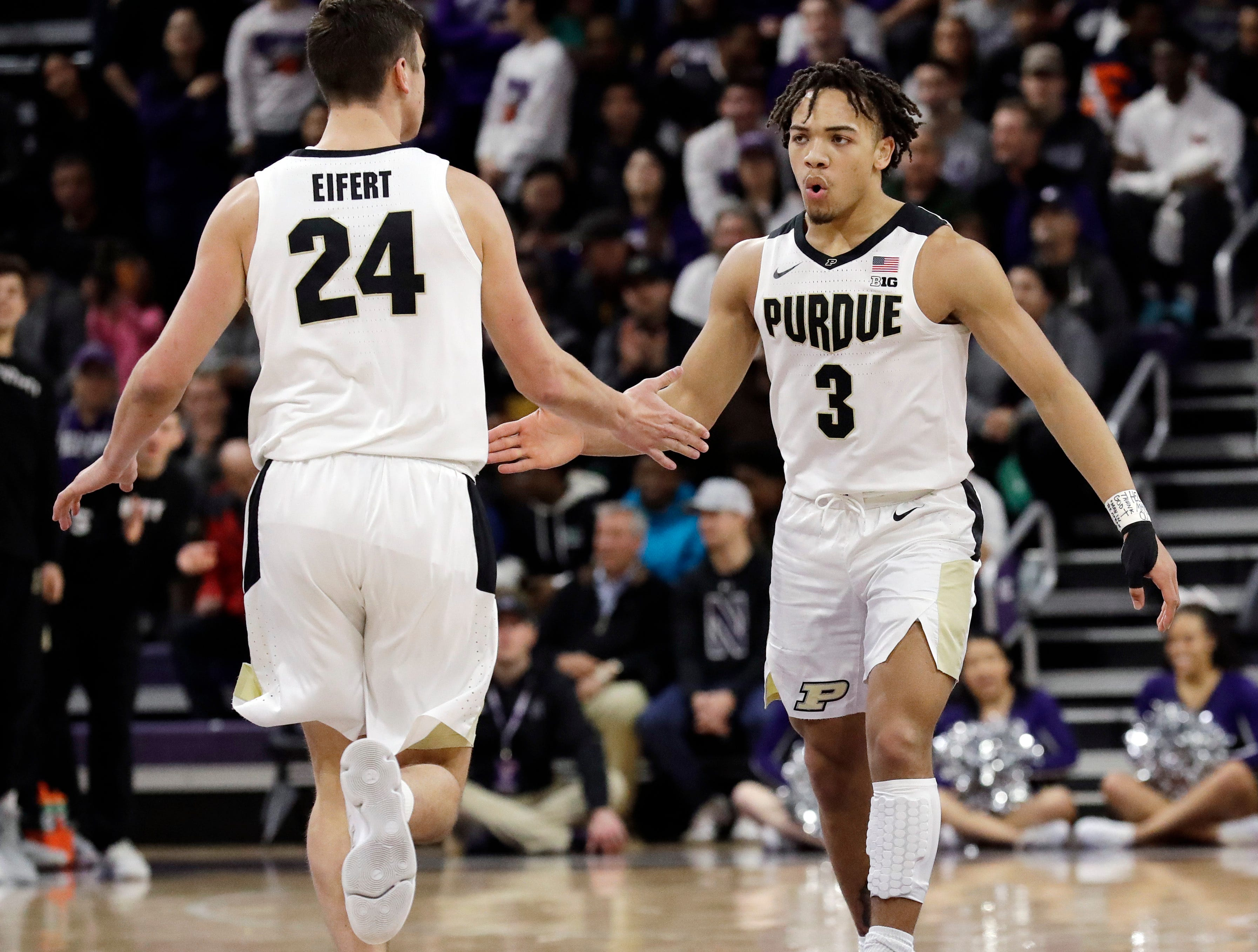 Purdue guard Carsen Edwards, right, celebrates with forward Grady Eifert after scoring a basket against Northwestern during the first half of an NCAA college basketball game Saturday, March 9, 2019, in Evanston, Ill