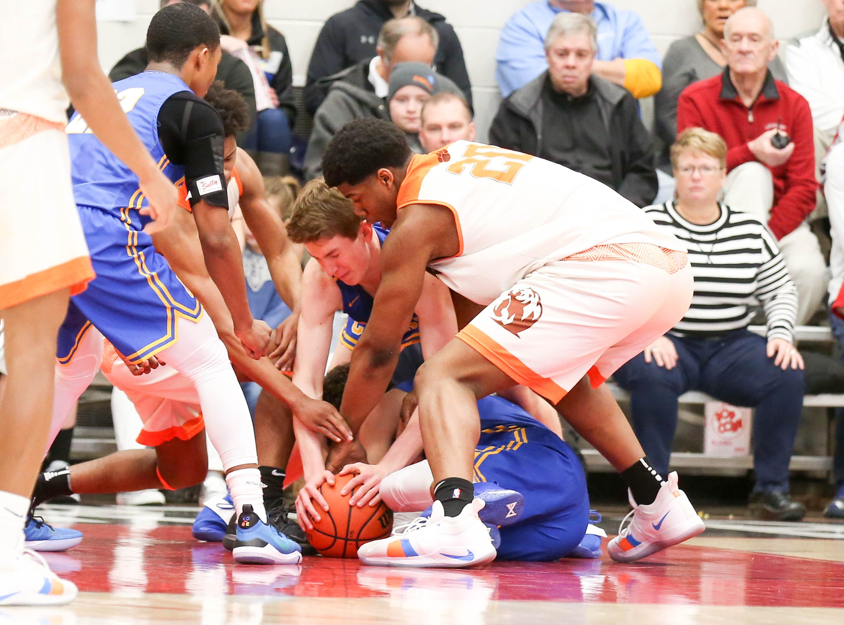 A scramble for loose ball during the second half of Carmel vs. Fort Wayne Northrop High School in the IHSAA Varsity Boys Regional Semifinals held at Logansport High School, March 9, 2019.