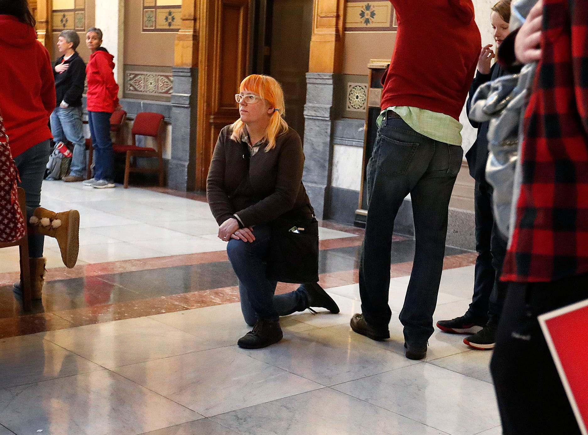 During the playing of the national anthem, one person chose to kneel on one knee in protest at the Indiana Red for Ed Rally at the Indiana Statehouse on Saturday, Mar 9, 2019. Teachers, educators and supporters were on hand to support public education and demand lawmakers provide more resources for our kids and increased pay for teachers.
