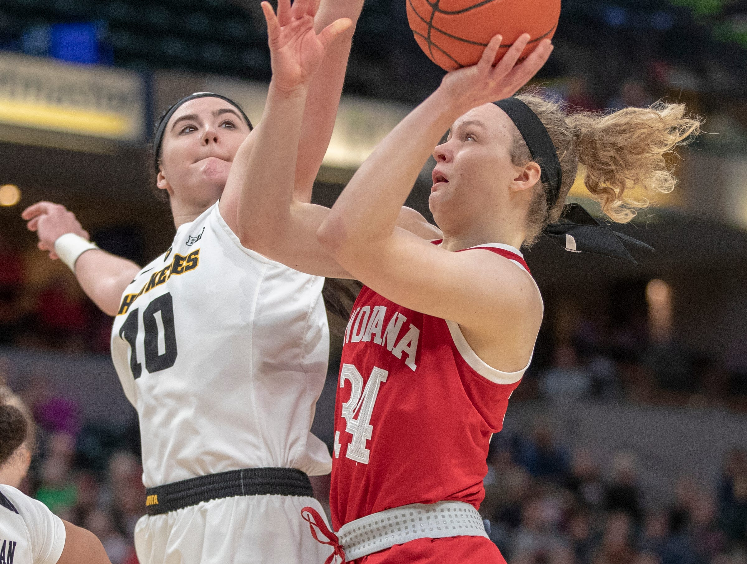 Megan Gustafson of the Iowa Hawkeyes blocks a shot by Grace Berger of the Indiana Hoosiers, first half action, Indiana vs. Iowa, Women's Big Ten Tournament, Bankers Life Fieldhouse, Indianapolis, Friday, March 8, 2019.
