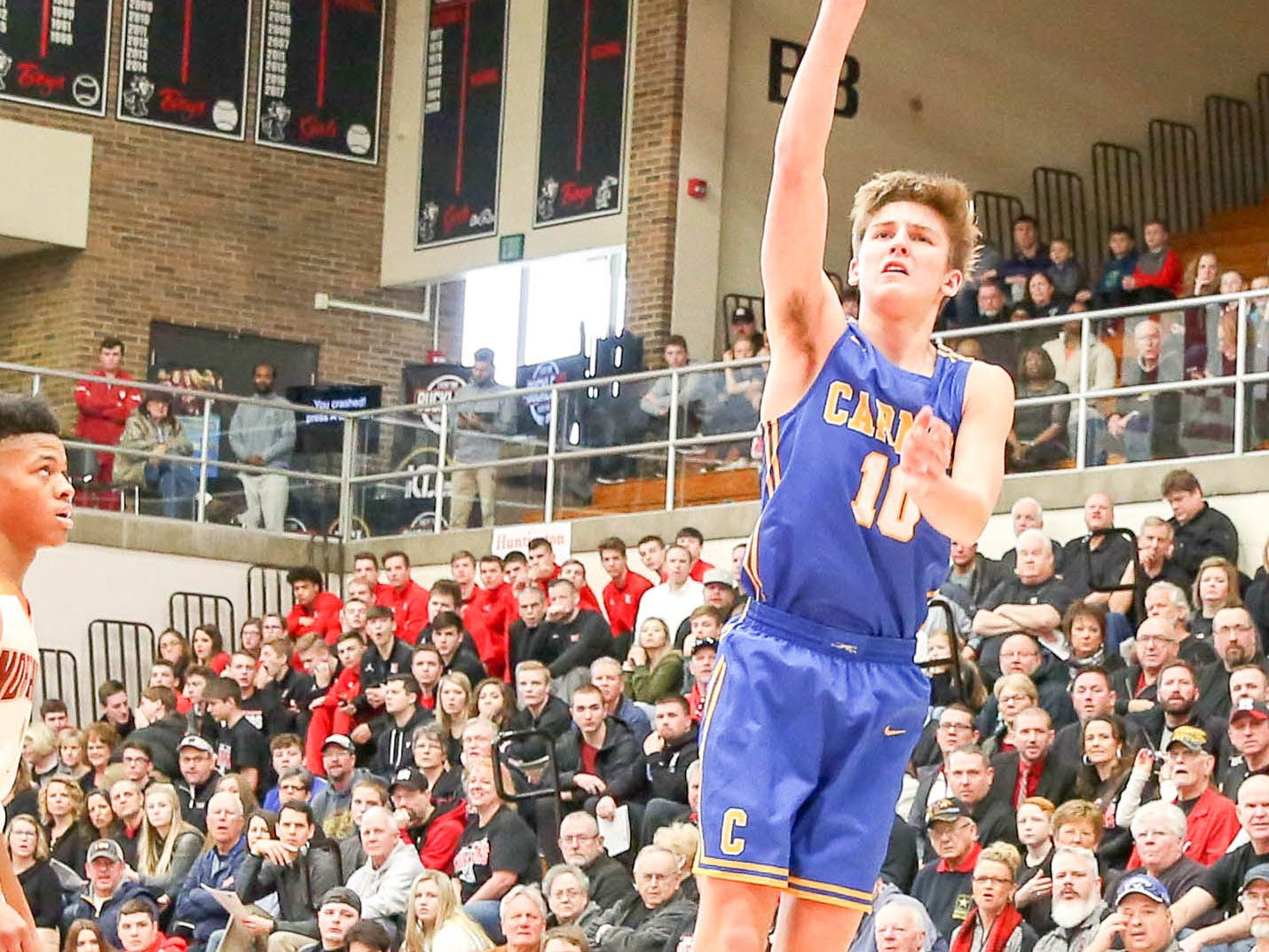 Carmel's Pete Suder (10) up for the long jump shot during the first half of Carmel vs. Fort Wayne Northrop High School in the IHSAA Varsity Boys Regional Semifinals held at Logansport High School, March 9, 2019.