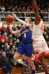 Carmel's Karsten Windlan (3) attempts to get past Sydney Curry (20) during Saturday's regional semifinal against FW Northrop. The Greyhounds beat Zionsville in the nightcap.