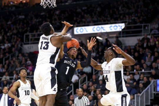 Bulldogs forward Jordan Tucker (1) is blocked by Providence College Friars forward Kalif Young (13) during the first half at Dunkin Donuts Center.