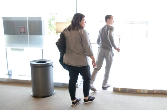 Kellie Lowry (left), walks with her son Michael Anderson at IU Health Neuroscience Center, Indianapolis, Wednesday, March 6, 2019.