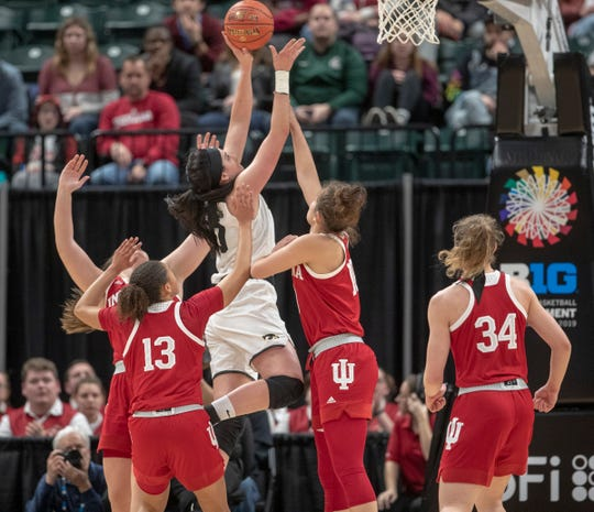 Megan Gustafson goes up against a crowd of Indiana defenders during the Hawkeyes' Big Ten Tournament opener on Friday at Bankers Life Fieldhouse.
