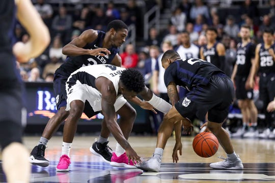 Providence College Friars guard Maliek White (4) battles for the ball with Butler Bulldogs guard Kamar Baldwin (3) during the second half at Dunkin Donuts Center.