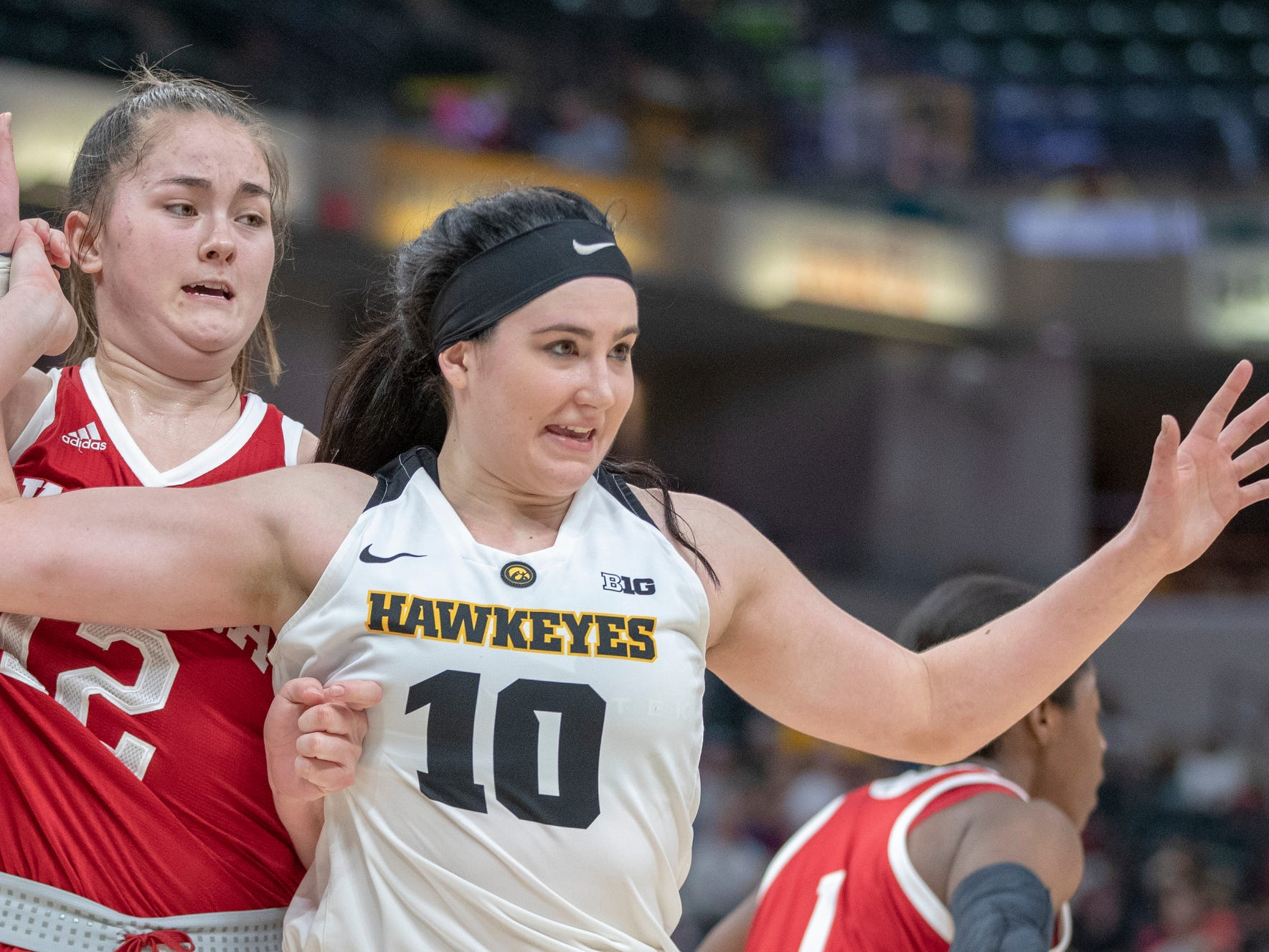 Linsey Marchese of the Indiana Hoosiers and Megan Gustafson of the Iowa Hawkeyes tangle up under the basket, Indiana vs. Iowa, Women's Big Ten Tournament, Bankers Life Fieldhouse, Indianapolis, Friday, March 8, 2019. Iowa won 70-61.