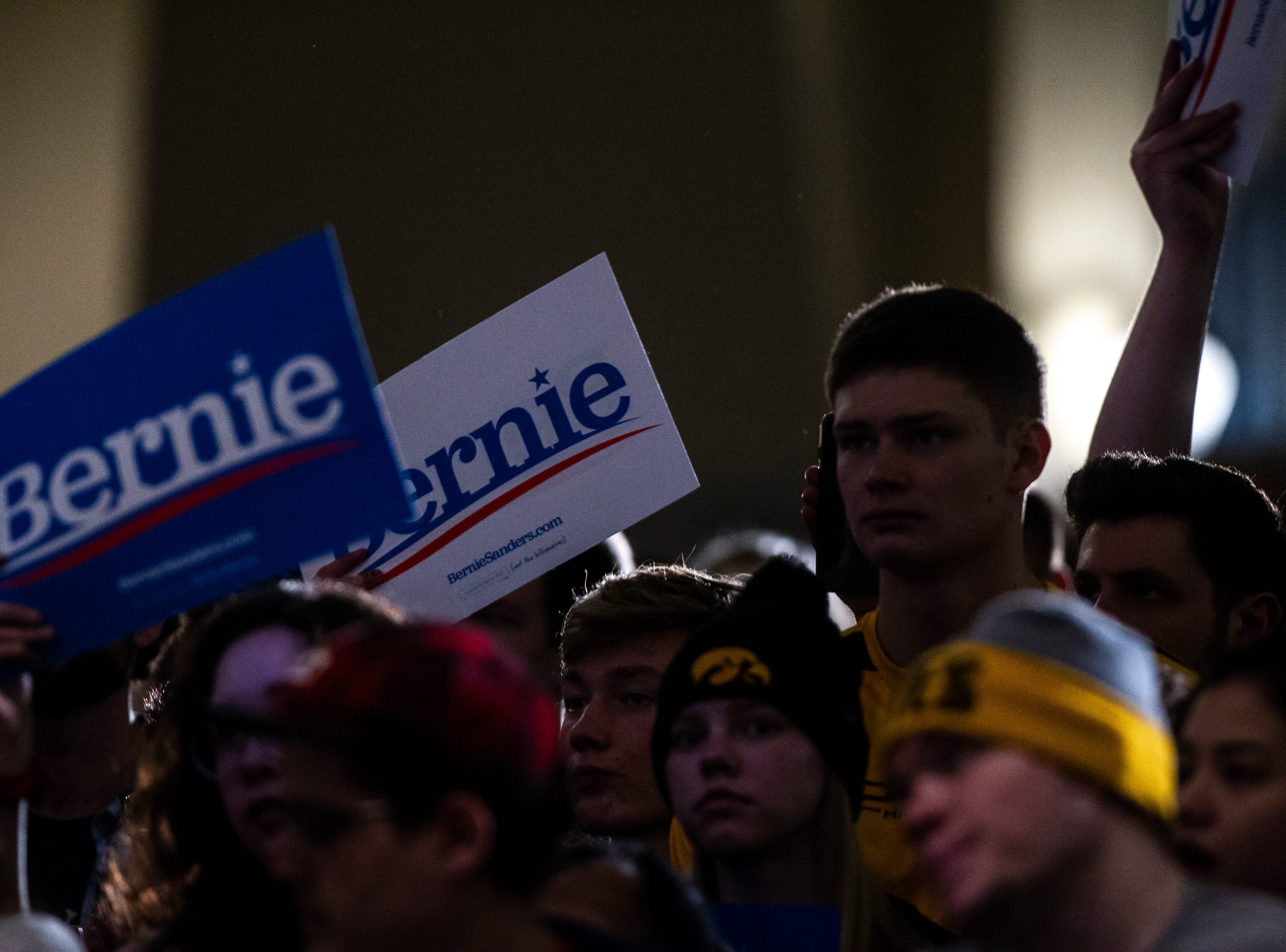 Members of the crowd hold up signs for U.S. Sen. Bernie Sanders, I-VT, at an event during his first trip to the state ahead of the caucus, Friday, March 8, 2019, at the Iowa Memorial Union on the University of Iowa campus in Iowa City, Iowa.