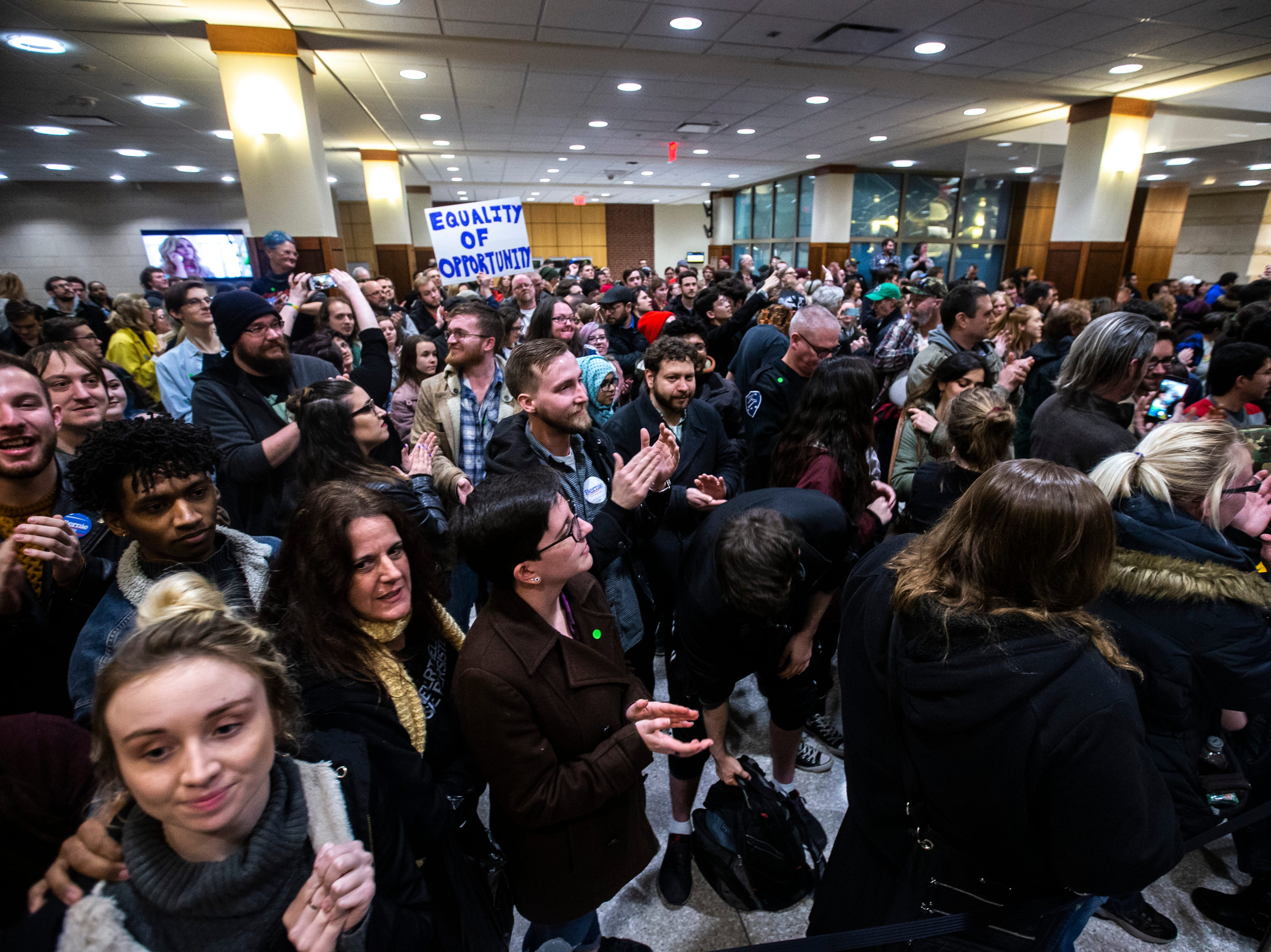 Members of the overflow crowd listen to U.S. Sen. Bernie Sanders, I-VT, speak at an event during his first trip to the state ahead of the caucus, Friday, March 8, 2019, at the Iowa Memorial Union on the University of Iowa campus in Iowa City, Iowa.