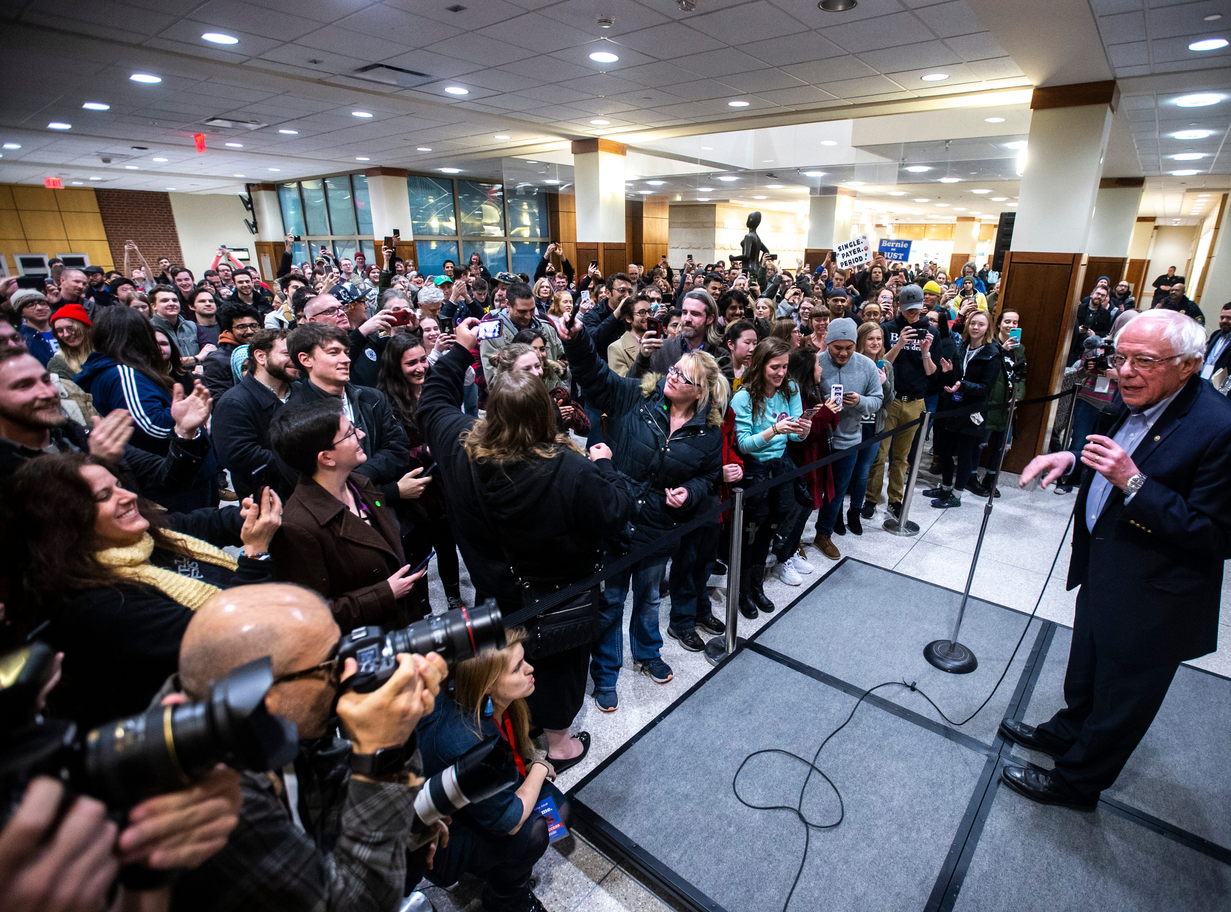 U.S. Sen. Bernie Sanders, I-VT, speaks to the overflow crowd at an event during his first trip to the state ahead of the caucus, Friday, March 8, 2019, at the Iowa Memorial Union on the University of Iowa campus in Iowa City, Iowa. More than 400 people were in the overflow crowd.