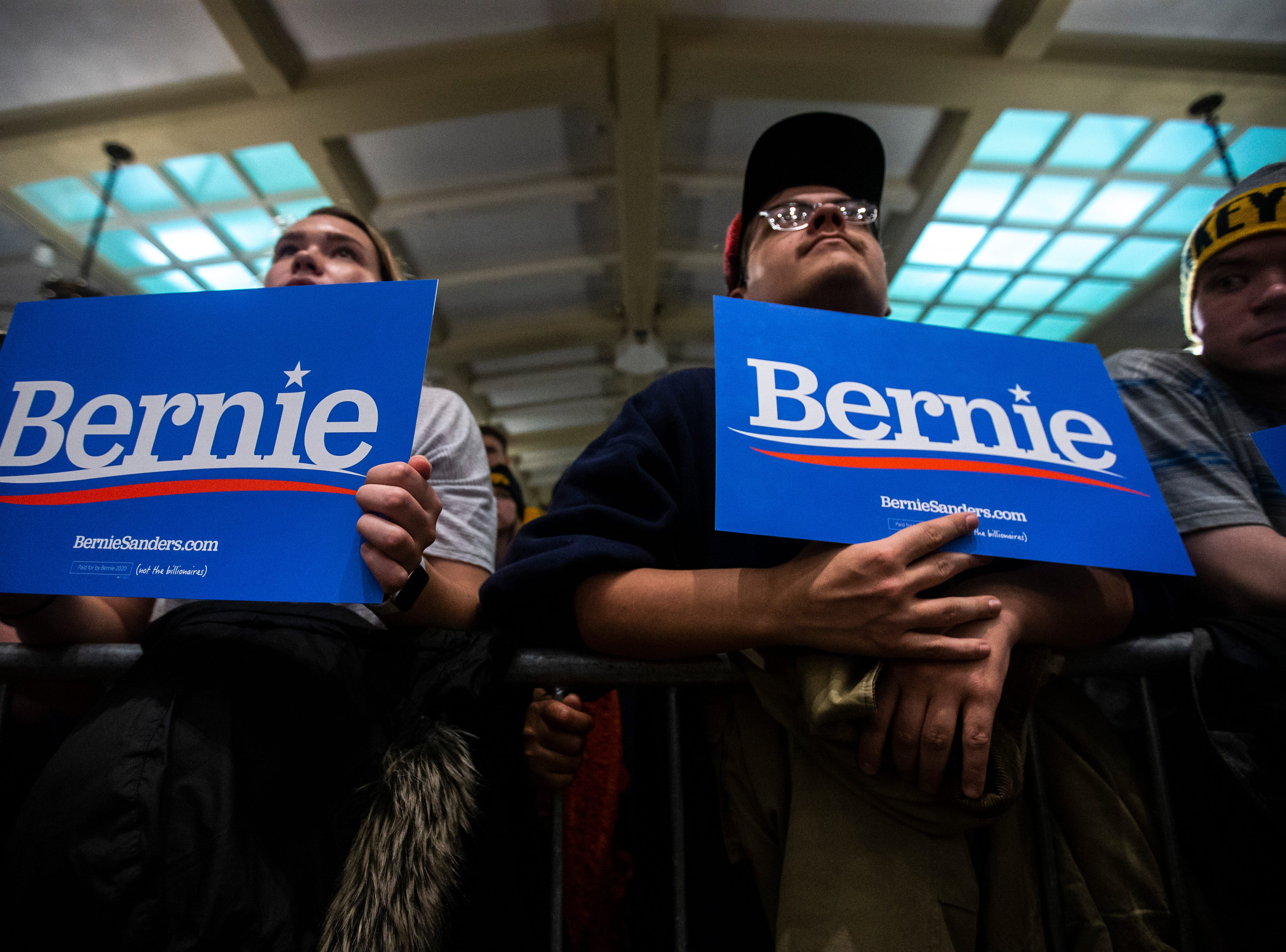 Supporters hold signs while listing to U.S. Sen. Bernie Sanders, I-VT, speak at an event during his first trip to the state ahead of the caucus, Friday, March 8, 2019, at the Iowa Memorial Union on the University of Iowa campus in Iowa City, Iowa.