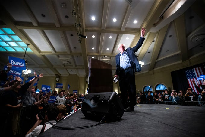 U.S. Sen. Bernie Sanders, I-VT, waves to supporters after speaking at an event during his first trip to the state ahead of the caucus, Friday, March 8, 2019, at the Iowa Memorial Union on the University of Iowa campus in Iowa City, Iowa. The official crowd size from the campaign was 1,804, including the overflow crowd that Sanders spoke to before his main speech.