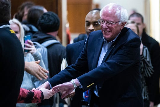 U.S. Sen. Bernie Sanders, I-VT, shakes hands with supporters before speaking to the overflow crowd at an event during his first trip to the state ahead of the caucus, Friday, March 8, 2019, at the Iowa Memorial Union on the University of Iowa campus in Iowa City, Iowa. More than 400 people were in the overflow crowd.