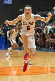 Center Hill's Calvin Temple (5) celebrates following the Mustangs 75-73 win over Olive Branch in the MHSAA 5A Boys Basketball Championship Finals held at the Mississippi Coliseum in Jackson, MS, Friday March 8th, 2019.(Bob Smith)