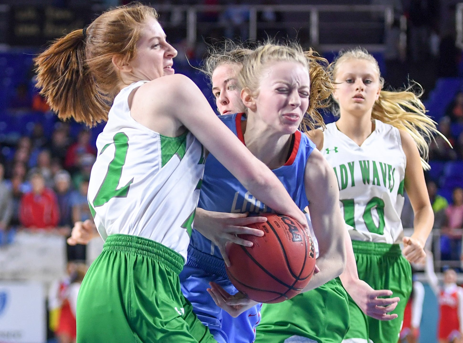 Gibson County's KJ White (32) attempts to go past Midway's Emily Cawood (22) during their Class A semifinal game, Friday, March 8, 2019, in  Murfreesboro.