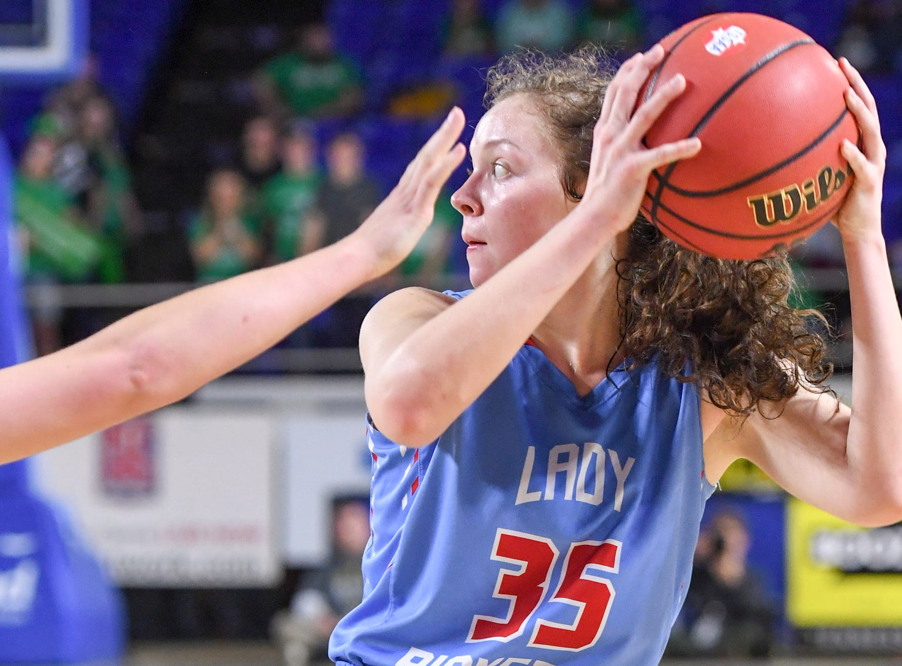 Gibson County's Hannah Ball (35) looks to pass the ball as a Midway defender puts her hand in her face during their Class A semifinal game, Friday, March 8, 2019, in  Murfreesboro. Gibson County defeated Midway, 75-61.