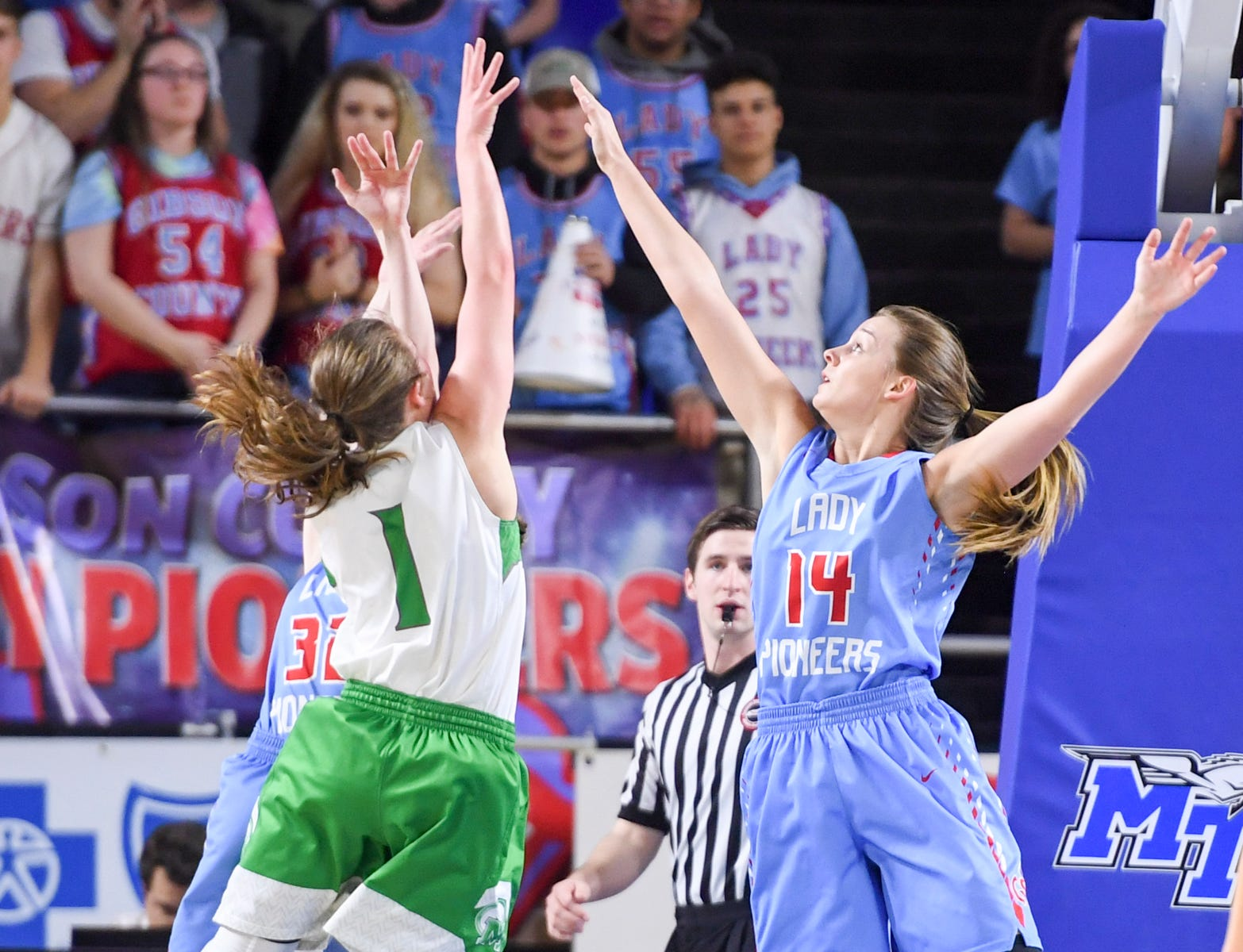 Gibson County's Alaina Hunt (14) reaches up in attempt to block the shot of Midway's Caitlyn Ross (1) during their Class A semifinal game, Friday, March 8, 2019, in  Murfreesboro.