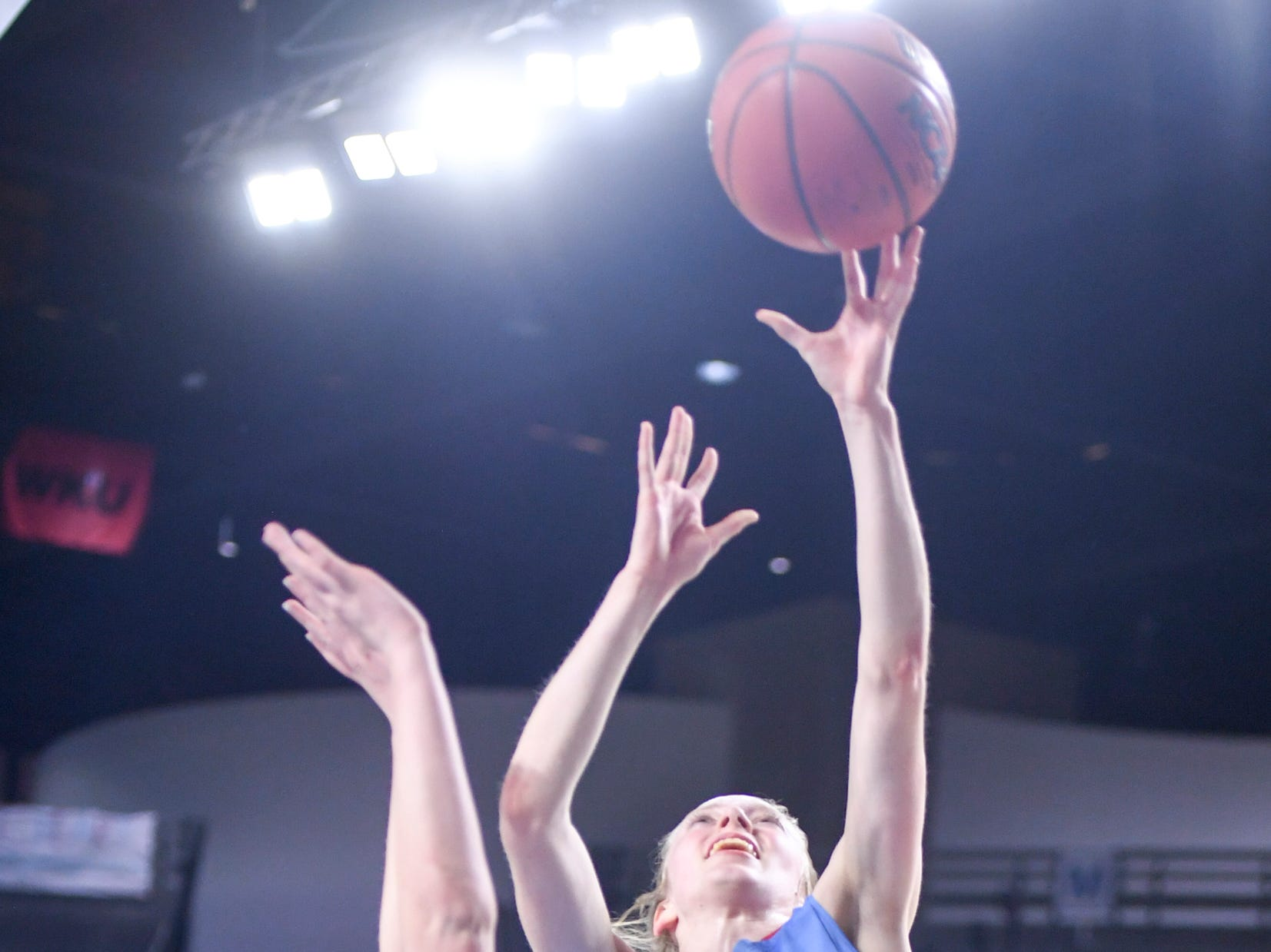 Gibson County's KJ White (32) goes up for a shot over Midway's Emily Cawood (22) during their Class A semifinal game, Friday, March 8, 2019, in  Murfreesboro.
