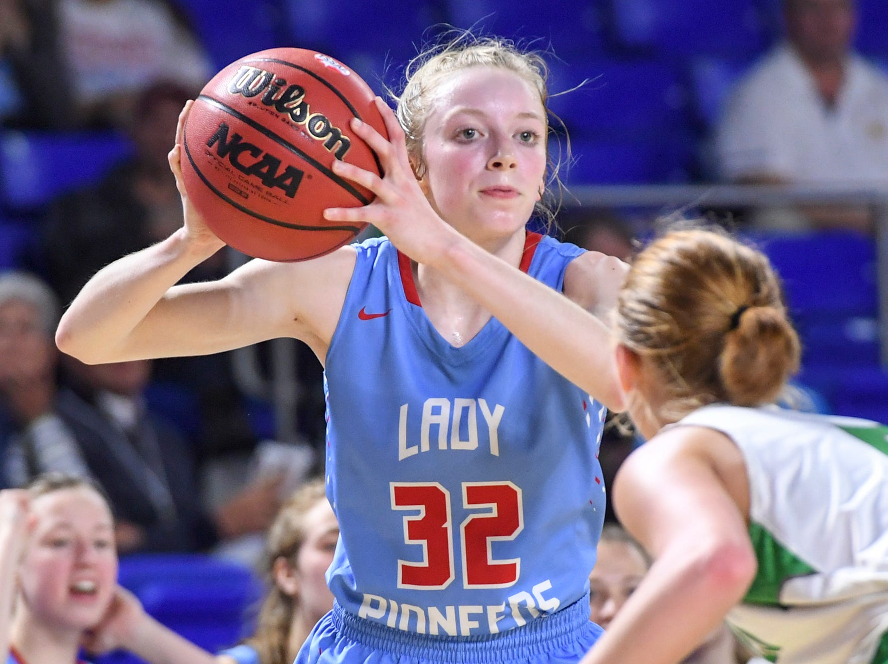 Gibson County's KJ White (32) is guarded by Midway's Paige Bacon (5) as she looks for an open teammate during their Class A semifinal game, Friday, March 8, 2019, in  Murfreesboro. Gibson County defeated Midway, 75-61.