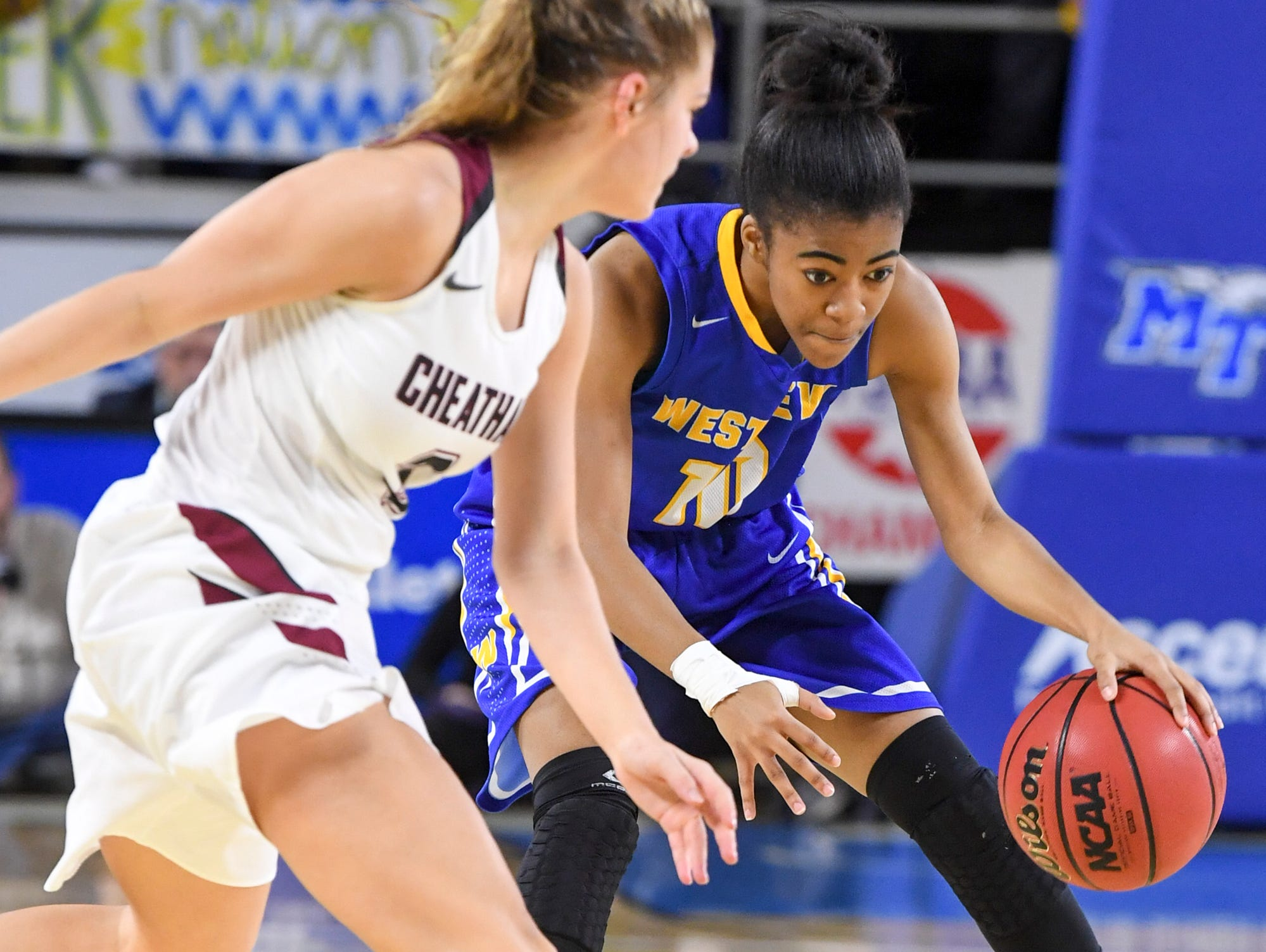 Westview's Zanasha Gadlen (10) crosses over Cheatham County's Emmy Nelson (3) during their Class AA championship game, Saturday, March 9, 2019, in Murfreesboro.