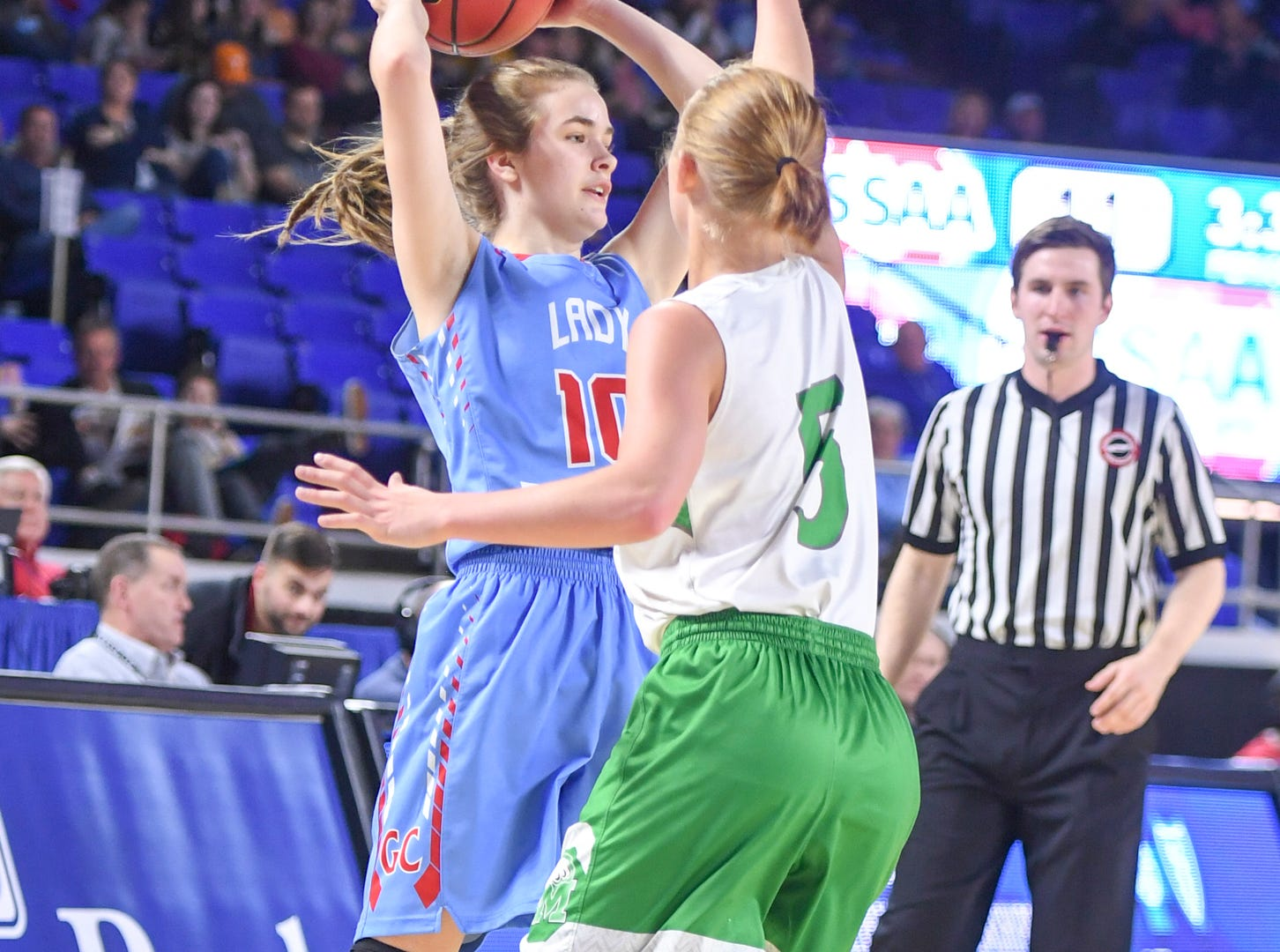 Gibson County's Kaci Sweatt (10) looks for an open teammate to pass to as Midway's Paige Bacon (5) guards her during their Class A semifinal game, Friday, March 8, 2019, in  Murfreesboro.