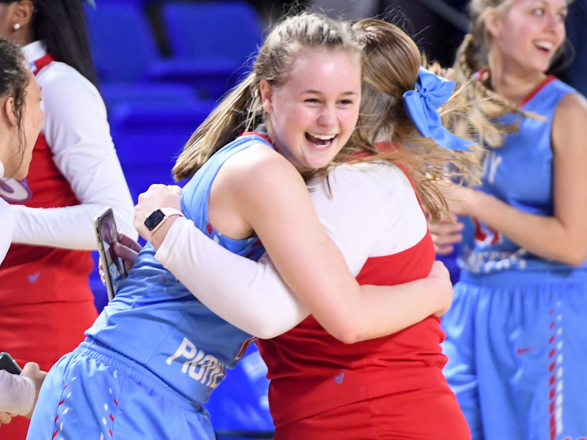 Gibson County's Ashton Lannom (1) receives a hug from a Gibson County cheerleader during their Class A semifinal game, Friday, March 8, 2019, in  Murfreesboro. Gibson County defeated Midway, 75-61.