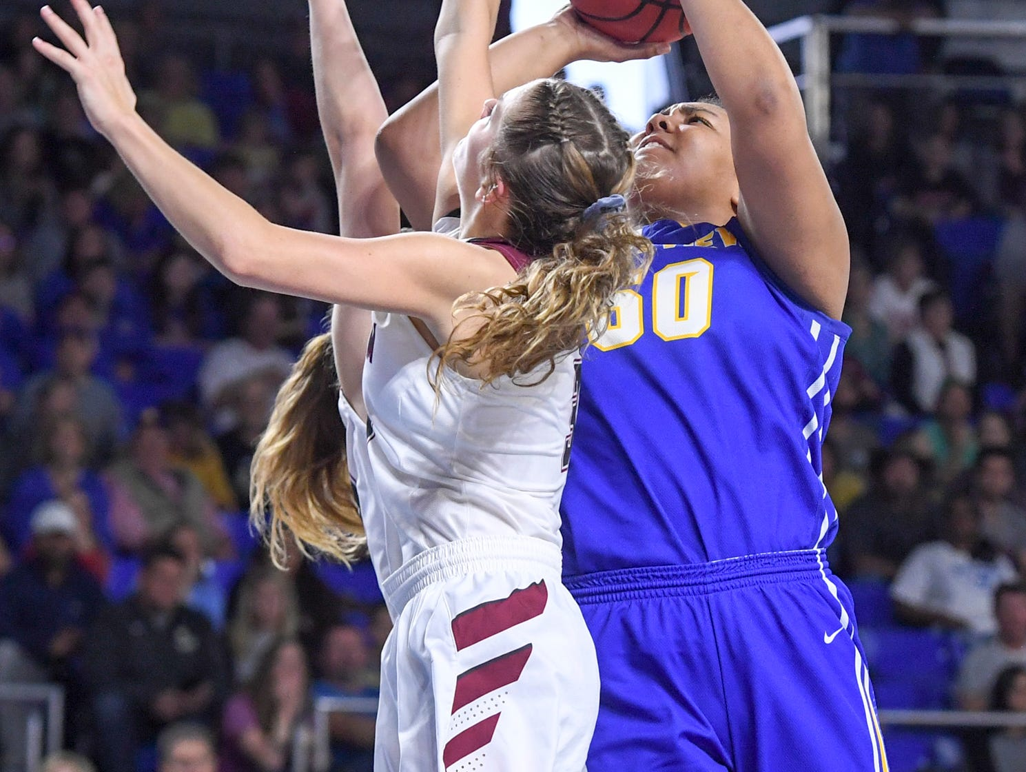 Westview's Raegan Johnson (50) goes up for a shot over two Cheatham County defenders during their Class AA championship game, Saturday, March 9, 2019, in Murfreesboro. Westview fell to Cheatham County, 43-40.