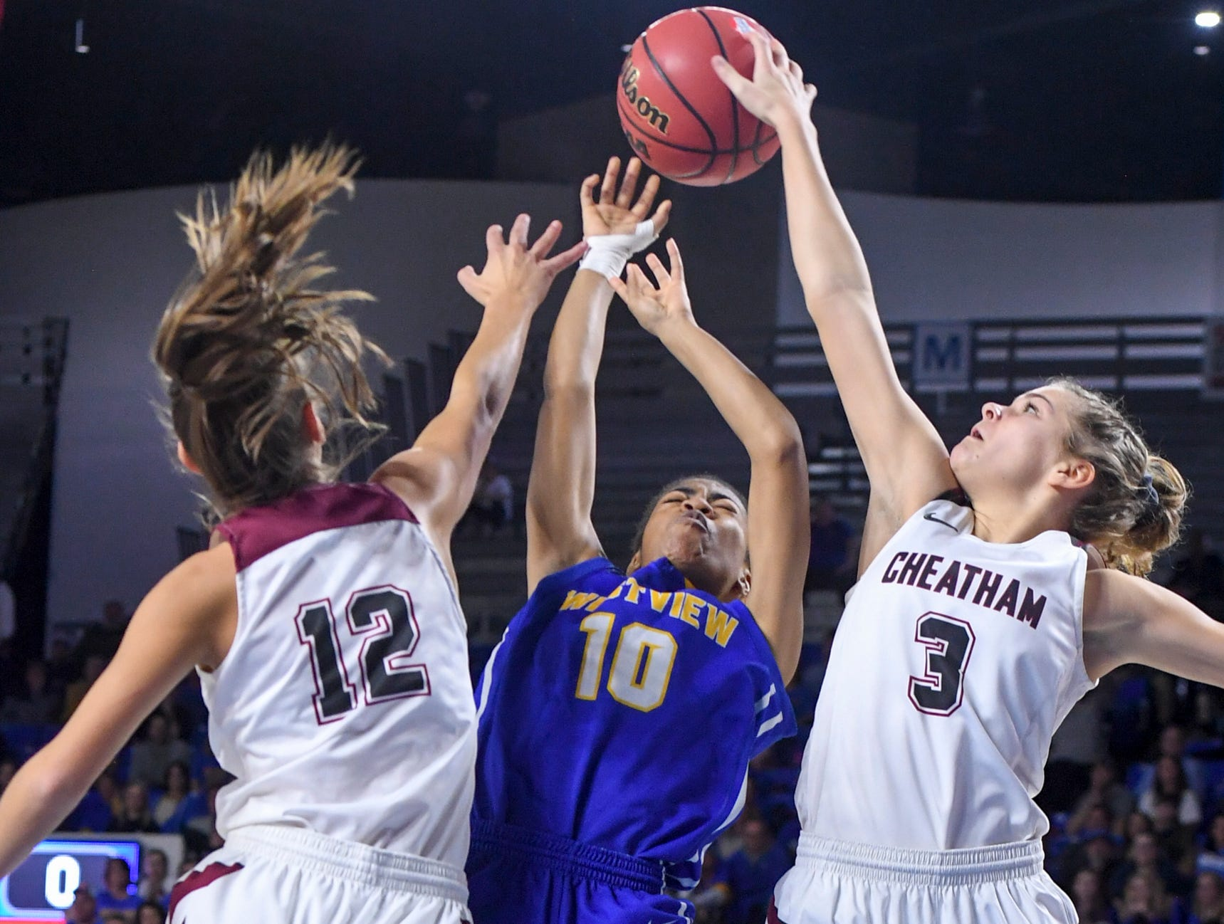Westview's Zanasha Gadlen (10) goes up for a shot between Cheatham County's Jorden Bumpus (12) and Cheatham County's Emmy Nelson (3) during their Class AA championship game, Saturday, March 9, 2019, in Murfreesboro.