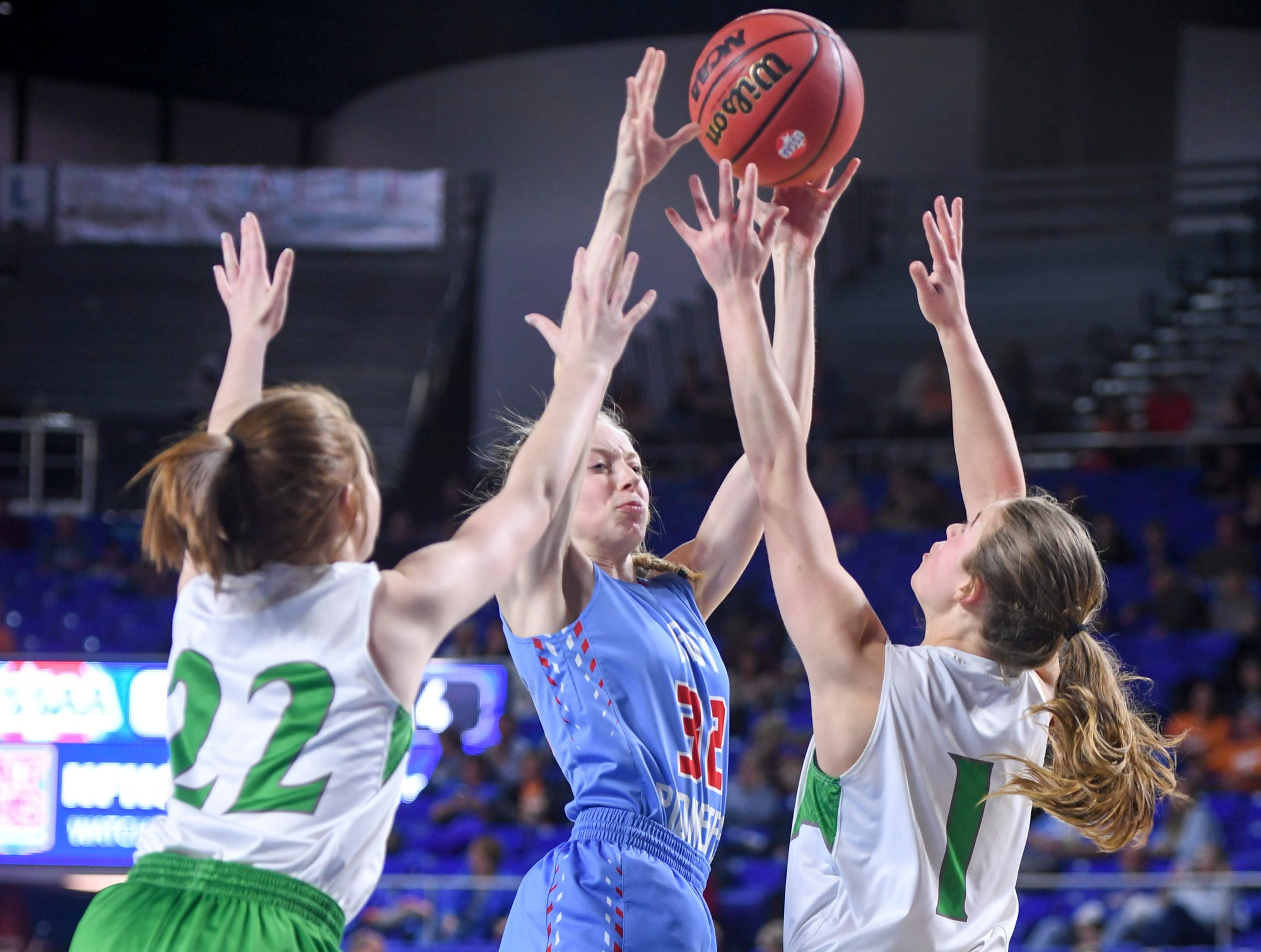 Gibson County's KJ White (32) attempts to split Midway's Emily Cawood (22) and Midway's Caitlyn Ross (1) during their Class A semifinal game, Friday, March 8, 2019, in  Murfreesboro.