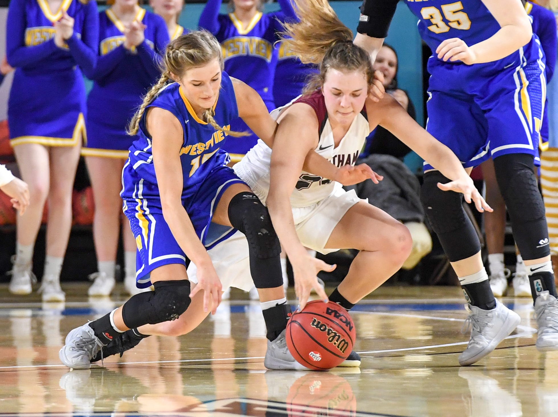 Westview's Alex Callins (15) and Cheatham County's Alli Douglas (24) dive for a loose ball during their Class AA championship game, Saturday, March 9, 2019, in Murfreesboro.