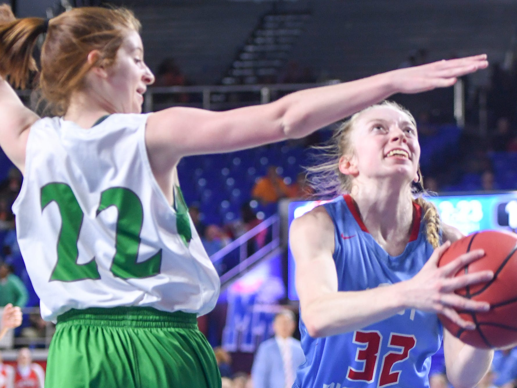 Gibson County's KJ White (32) gets past Midway's Emily Cawood (22) during their Class A semifinal game, Friday, March 8, 2019, in  Murfreesboro.