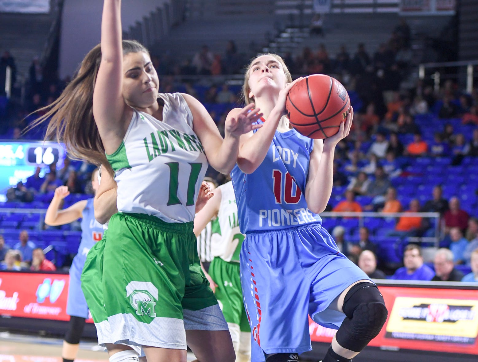 Gibson County's Kaci Sweatt (10) is guarded by Midway's Megan Norman (11) as Sweatt goes up for a shot during their Class A semifinal game, Friday, March 8, 2019, in  Murfreesboro.