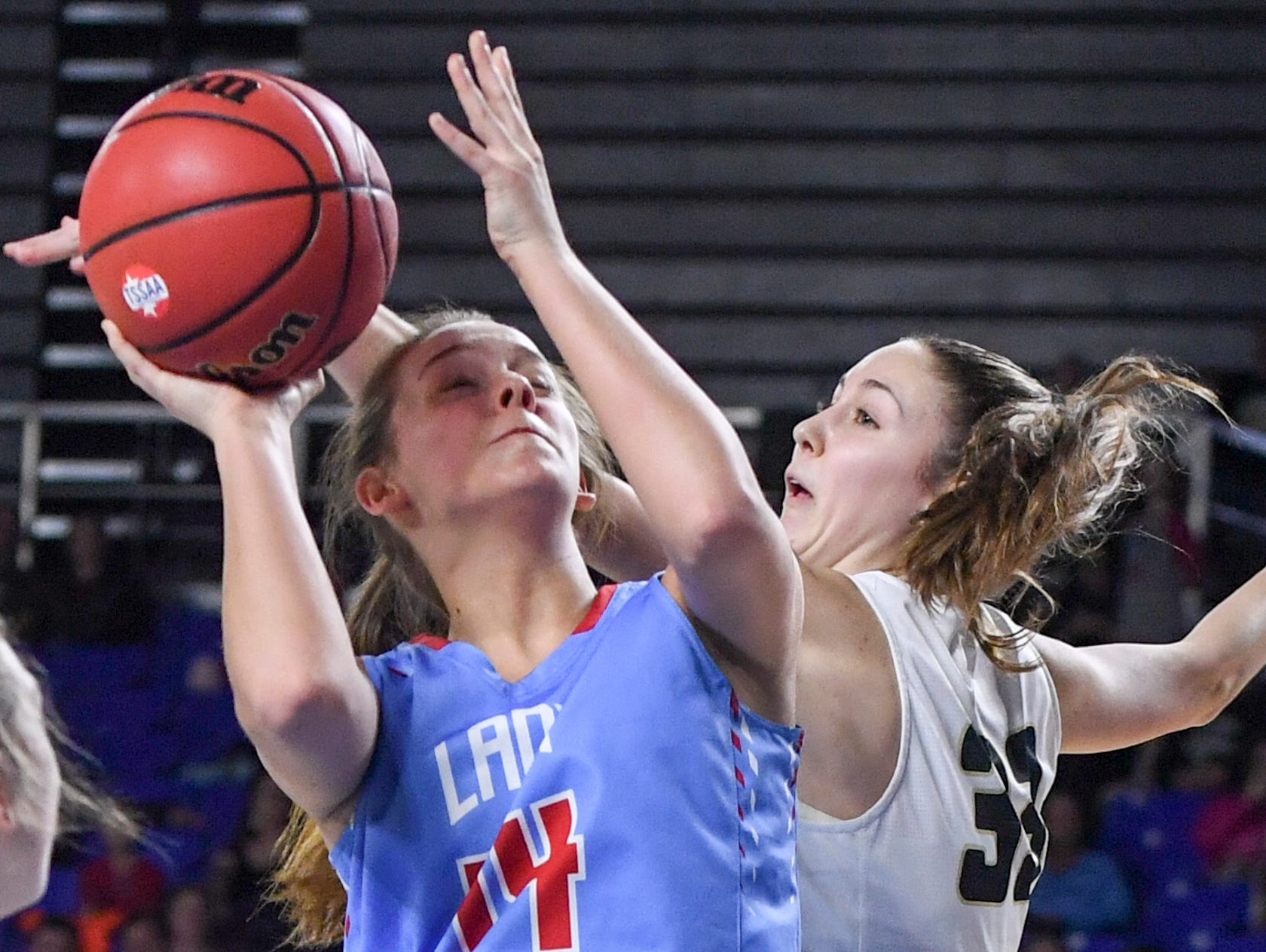 Loretto's Kensey Weathers (33) jumps up to block the shot of Gibson County's Alaina Hunt (14) during their Class A championship game, Saturday, March 9, 2019, in Murfreesboro.