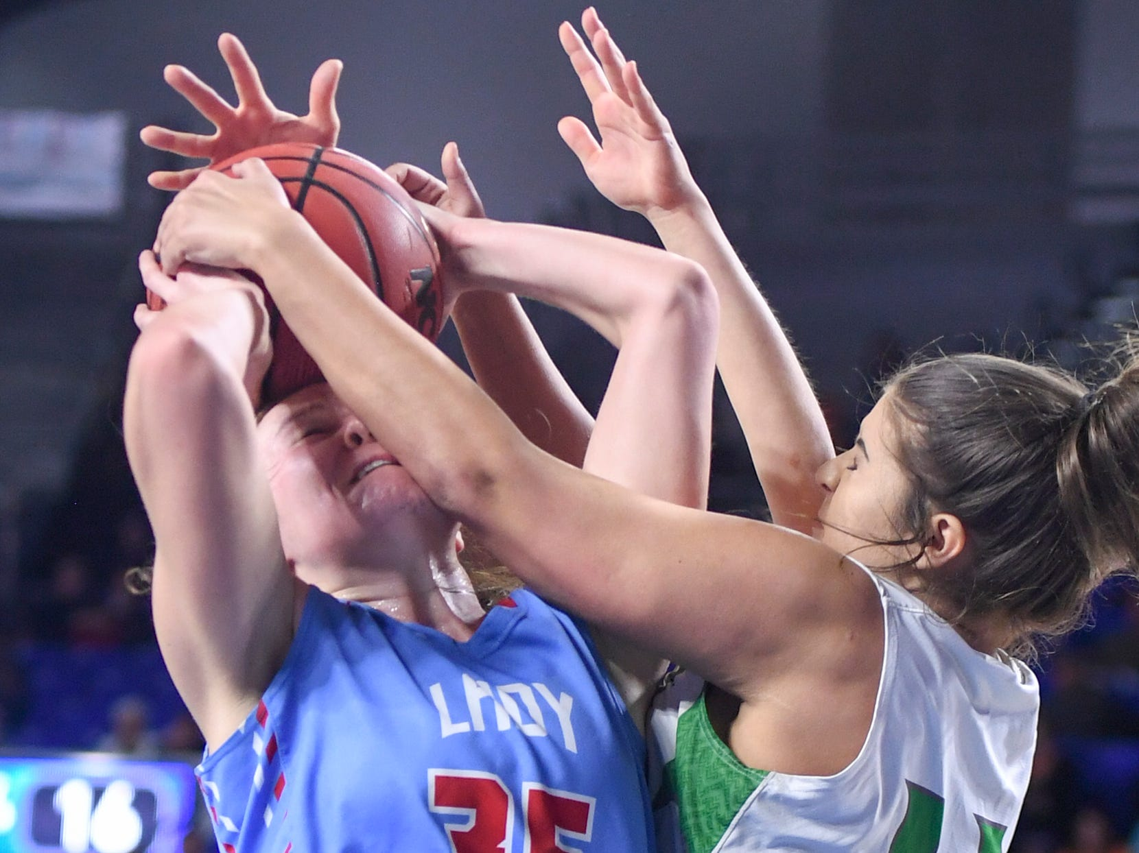 Midway's Megan Norman (11) and Gibson County's Hannah Ball (35) battle for a rebound during their Class A semifinal game, Friday, March 8, 2019, in  Murfreesboro.