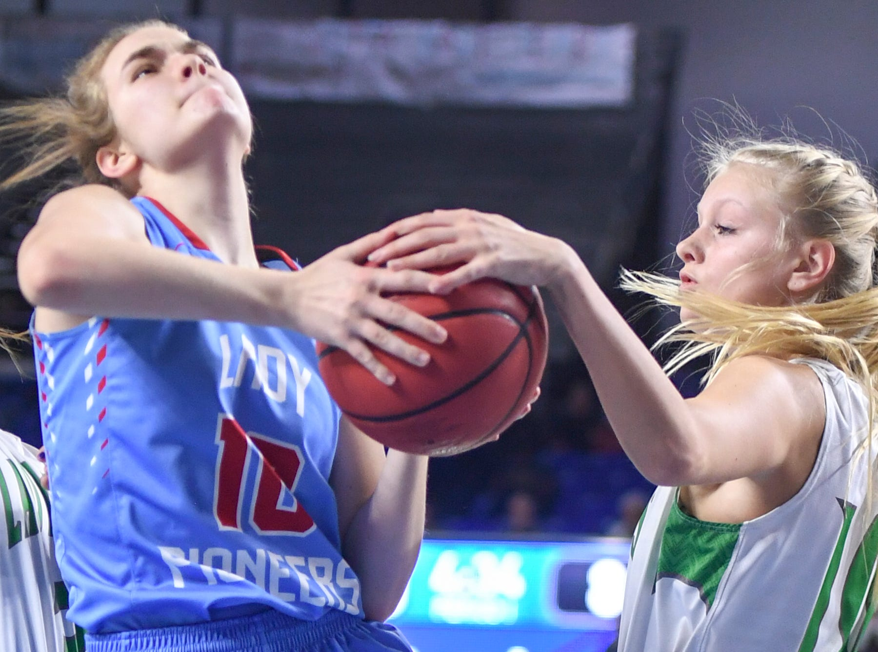 Midway's Heaven Prinzi (10) grabs the ball as Gibson County's Kaci Sweatt (10) attempt to go up for a shot during their Class A semifinal game, Friday, March 8, 2019, in  Murfreesboro.